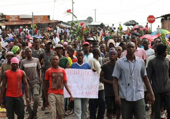 Protesters walk along a street in the ongoing protest against Burundi President Pierre Nkurunziza and his bid for a third term in Bujumbura