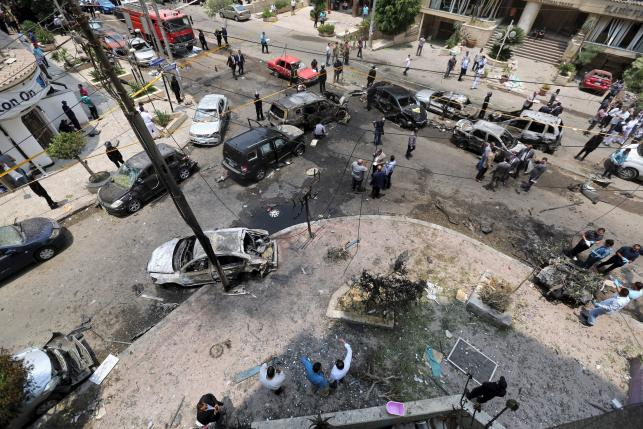 A view shows burnt cars at the site of a car bomb attacked the convoy of Egyptian public prosecutor Hisham Barakat near his house at Heliopolis district in Cairo, Egypt, June 29, 2015.  REUTERS/Mohamed Abd El Ghany