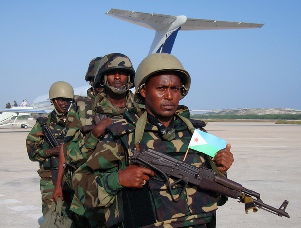 The first African Union contingent from Djibouti arrive at Mogadishu?s Adan Ade international airport on December 20, 2011. Somali government officials reported the first contingent consisted of 200 heavily equipped troops from Djibouti with more to follow.  The troops, who marched out of the airplane in combat uniform and carrying rifles, were welcomed at Mogadishu airport by top Somali military officials and African Union Mission in Somalia (AMISOM) leaders. Djibouti, which neighbours Somalia, is the latest country to deploy troops to Somalia, as regional states use military force to engage the extremist Al-Shebab insurgents of southern Somalia .AFP Photo/Mohamed Abdiwahab (Photo credit should read Mohamed Abdiwahab/AFP/Getty Images)