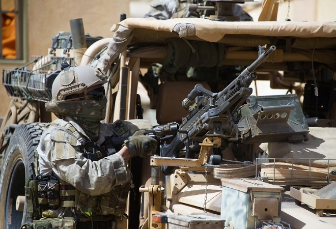 """This handout picture released on April 6, 2015 by the French Defense Audiovisual Communication and Production Unit (ECPAD) shows a member of the French special forces standing next to a machine gun mounted on a vehicle in Mali. French special forces on April 6, 2015 rescued Dutch train driver Sjaak Rijke, kidnapped in Timbuktu in northern Mali in November 2011 by Al-Qaeda in the Islamic Maghreb (AQIM), in an operation that killed several jihadists.  AFP PHOTO / ECPAD = RESTRICTED TO EDITORIAL USE - MANDATORY CREDIT """"AFP PHOTO / ECPAD"""" - NO MARKETING NO ADVERTISING CAMPAIGNS - DISTRIBUTED AS A SERVICE TO CLIENTS - TO BE USED WITHIN 30 DAYS FROM 06/04/2015=="""